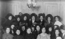 Group_of_mainly_female_shirtwaist_workers_on_strike,_in_a_room,_New_York